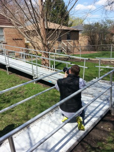 Photographer Elliot Mandel captures a shot of the accessibility ramp at Hartrey South.