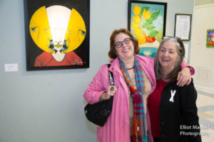 Art show organizer Kathy Miller (r) and guest.
