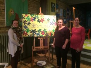 Carolyn Keel, Tina Jones, and Bridget Crump pose with the completed mural.